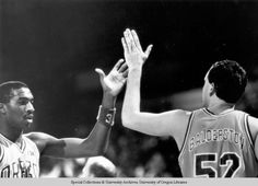 Black and white photo of University of Oregon basketball players Richard Lucas ( and Keith Balderston ( congratualting each other after a play in a game during the season. ©University of Oregon Libraries - Special Collections and University Archives Basketball History, Basketball Players, University Of Oregon, Libraries, Collections, Seasons, Black And White, Game, History Of Basketball