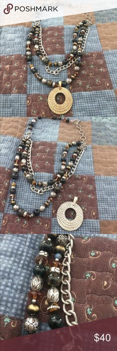 Premier Designs Lovely Premier designs necklace. New. With removable pendant enhancer. The pendant can be flipped to wear silver or gold side. Also removable piece to make necklace shorter or longer. 2 multicolored strands of beads and one silver chain strand. Premier Designs Jewelry Necklaces