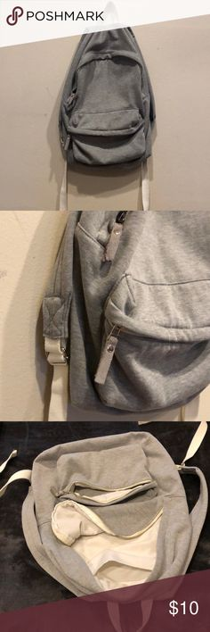 "Cloth grey backpack ""Soft sweatpants type feel"" Backpack! Has 2 zippers. One huge main compartment with a cellphone pocket inside the main compartment . One smaller zip pocket in the front. White details. Silver zippers. Has lots of room for all kinds of gear! PacSun Bags Backpacks"