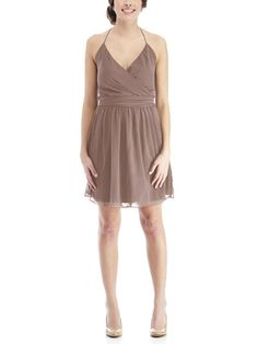 Joanna August DC Short is a cocktaillength, V neck halter bridesmaid dress with adjustable spaghetti straps and a flattering wrap style that can be tied in front or back for an effortless look. The DC Short is made of chiffon.