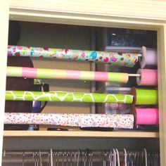 Tension rods, wrapping paper, and coordinating ribbons make space in a small closet