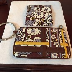 Smart phone wristlet and credit card case. Wristlet has inside pocket and divider for phone and bills. Zipper top. Credit card case has two pockets. 7 in wide, 4 1/2 in deep. Vera Bradley Bags Clutches & Wristlets
