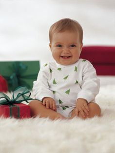 stamped onesie: Start with a white cotton onesie. Buy a rubber Christmas stamp and a fabric ink pad at a craft, stationary, or Christmas store. Put a layer of clean cardboard inside the onesie (to keep the ink from soaking through), then lay the garment on a flat, hard surface and tape down the edges so the fabric is taut. Stamp using steady pressure. Let dry for 10 to 15 minutes, then press with a hot iron to set the ink so it won't run.