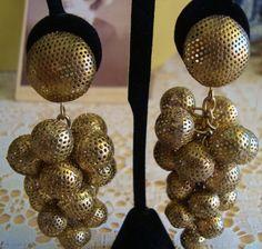 Vintage Mid Century Modern Brass Mesh Earrings $18.50, via Etsy.