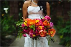 This bright orange, hot pink, and yellow wedding bouquet was perfect for this multicultural Indian wedding in Seattle! | Shane Macomber Photography