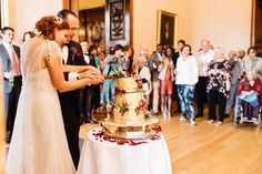 The most beautiful real wedding at Ashridge House with fabulous red florals and a stunning couple - images by Steven Anthony Photography