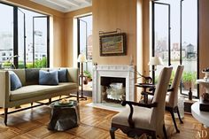 Angus Wilkie and Len Morgan, the owners of Cove Landing antiques, updated a New York penthouse apartment. A George III sofa with pillows in a Fortuny fabric joins burlap-clad antique Irish armchairs and a 1970s Silas Seandel bronze low table in the living room. An André Brasilier painting hangs above the Regency mantel from Chesney's; the 19th-century parquet floor is from Axel Vervoordt.