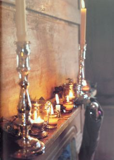 Rustic mantle with silvered mercury glass and votives
