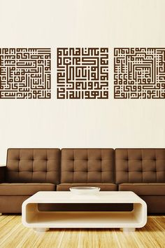 "3 Qul - Mu`awwadhat (Surah Ikhlas - Surah Falaq - Surah Naas) Wall Sticker. 3 Qul (in kufi square) is also known as Mu`awwadhat. It has been narrated in Bukhari and Muslim from `A'isha (Allah be pleased with her) that, ""When the Prophet (Allah bless him and give him peace) use to take his place of resting, he used to blow into his two hands and recite the Mu`awwadhat (Surah al-Ikhlas, al-Falaq, al-Naas) and pass and wipe his hands over the body."" http://walliv.com/3-qul-mu-awwadhat"