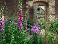 Entrance to the restored Victorian Kitchen Gardens at Combe House Hotel in Devon