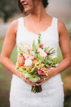 fiesta inspired bouquet, photo by Inkspot Photography http://ruffledblog.com/mexican-ranch-wedding-ideas #flowers #weddingbouquet
