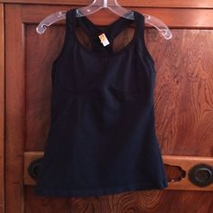 Lucy black tank sz med Black tank has a zippered pocket on back comes with pads has mesh on back and straps Lucy Tops Tank Tops