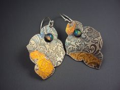 Opal earrings with gold foil on silver.