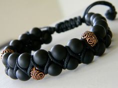 The Boho Collection of beaded necklaces and bracelets is made with genuine gemstones. Two rows of 8mm matte Onyx accented with three handmade Copper beads and anchored with black soutache in a V design.
