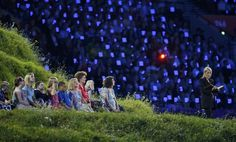 London 2012 Opening Ceremony - J.K. Rowling, author of the Harry Potter fantasy series, reads during the opening ceremony of the London 2012 Olympic Games at the Olympic Stadium July 27, 2012. REUTERS/Mike Segar (BRITAIN - Tags: OLYMPICS SPORT)