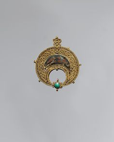 11th century Egyptian pendant. gold filigree. turquoise. love how the cloisonne method is  similar to those used by medieval celts! Such a beautiful piece.