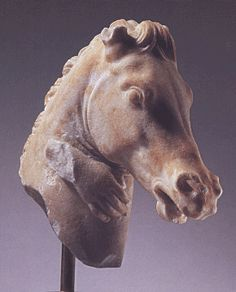 Greek marble head of a horse, 4th/3rd Century B.C., 8 3/4 inches high   Lot 67 is a very fine Greek marble head of a horse, circa late 4th/3rd Century B.C., 8 3/4 inches high. The beautifully carved work has the hand of a child clasping the neck, which adds immensely to its charm.