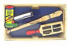 Beginner Band in a Box 2 by Melissa & Doug. $9.95. Perfect for your little rock star in the making!!. Instruments include jingle stick, harmonica and recorder. Ages 3 +. A solid wooden base-box for instruments to sit in. Includes (3) three beginner instruments. The Beginner Band in a Box by Melissa & Doug is a colorful new instrument set perfect for introduction into the fun world of making music. Instruments help teach both teamwork and individual creativity. Each s...