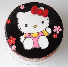 Hello Kitty Cake.  I shudder at the black buttercream, but the hello kitty part is super cute.