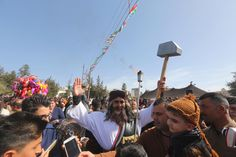 """Rudaw English on Twitter: """"In solidarity with #Afrin: A man in Sulaimani city dresses up as Kawa the blacksmith, the statue of whom was recently demolished by Turkish-backed forces in Afrin canton. 📸Rudaw/Sartep Othman.… https://t.co/C1hFQ9VTCy"""""""