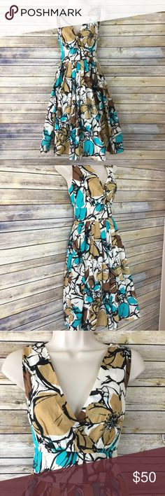 ARYEH Glamour Power To You Mod Retro Vintage Dress Style description: ARYEH Glamour Power To You Mod Retro Vintage Dress. THIS is what other fit and flair dresses aspire to be. It resembles 1950s Marilyn Monroe charm. This 100% cotton dress has a flattering surplice front and back, banded waist, and bold floral pattern.  Size: M  Condition: This dress is so gorgeous and in excellent condition. Looks as though it's never been worn.  Measurements available upon request and all are taken while…