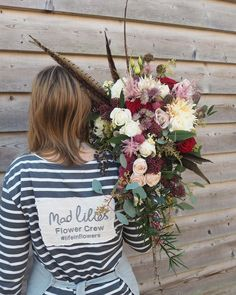 Lucys cascade bouquet complete with pheasant feathers.....