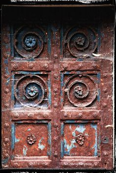 Rusty crypt doors in the Brompton cemetery