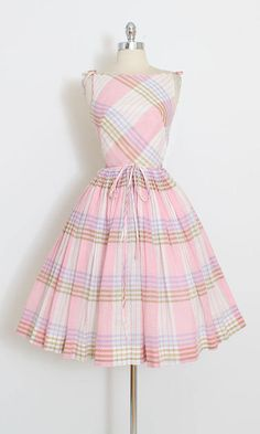 ➳ vintage 1950s dress * sweetest little dress! * swiss dot pink plaid cotton * cotton and tulle linings * shoulder ties * full skirt * metal side zipper * double tie belt * by Joan Miller Jrs condition | excellent fits like xs length 43 bodice 17 bust 34 waist 22-23 hem allowance 2 ➳ shop http://www.etsy.com/shop/millstreetvintage?ref=si_shop ➳ shop policies http://www.etsy.com/shop/millstreetvintage/policy twitter | MillStVintage faceboo...