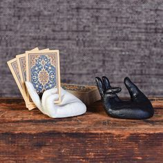 $72.00 HomArt Single Hand Card Holder - Set of 4 Everyone needs an extra hand! Our sturdy cast iron hand offered in a single zen hand soundly hold cards, photographs, memos or small books.
