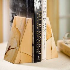 Triangle Natural Marble Bookends - The warm multi-hued brown tones in these Triangle Natural Marble Bookends make them a subtle yet lovely addition to any room. Although traditional in ...