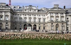 """Even if the flowers aren't out yet, this wonderful installation of 10,000 clay flowers will make your heart sing. Called Out of Sync, they are """"planted"""" in the courtyard of London's Somerset House.Set against the grand architecture of the 18th century museum, the flowers signal the end of winter and the beginning of spring. The spectacular piece was created by a Chilean artist, Fernando Casasempere."""