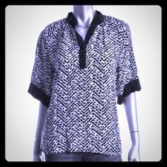 Yumi Kim 100% Silk Top Yumi Kim 100% Silk top. Black and white pattern. Size XS can fit a 0-4 NWT Yumi Kim Tops