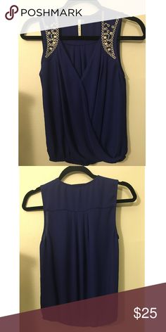 Blue tank with white embroidering Blue tank with white embroidering on the shoulders. Also has an elastic at the waist. Price Negotiable! Urban Outfitters Tops Tank Tops
