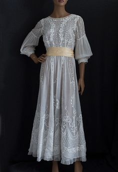 Hand-embroidered tea dress, c.1905. Made from sheer cotton batiste embellished with padded hand embroidery and lace inserts
