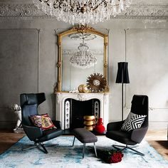 Living room with ornate mirror and leather seating // living room