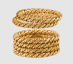 TIFFANY & CO. WOVEN GOLD STACKING RINGS This gold ring stack that is both timeless and current! Tiffany & Co. 18 karat yellow gold woven stacking band rings. Four bands are attached and two are separated- they all combine to a width of approximately 0.50 inches. Circa 1970s. #CraigEvanSmall #Tiffany&Co #Gold #VintageRings #Rings