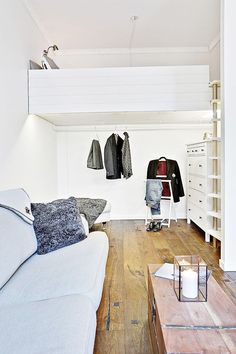 This Studio Apartment Looks Triple Its Actual Size #refinery29  http://www.refinery29.com/living-in-a-shoebox/15#slide-1  Accessible via a wall ladder, the raised loft bedroom is perfectly sized for a queen bed. Downstairs, a dresser and clothing nook keep the bed area free of extra clutter.