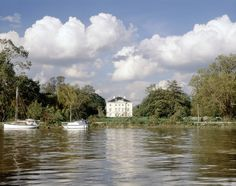 South front of house with River Thames and boats in foreground