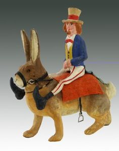 Uncle Sam on rabbit, German candy container, Dan Morphy Auctions