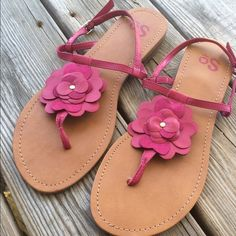 Pink sandals Final reduction. Hot pink sandals with sweet leather flower! Brand new, never worn, did not come with a box. Adjustable straps. True to fit size 9! Perfect summer sandal! Bundle and save! SO Shoes Sandals