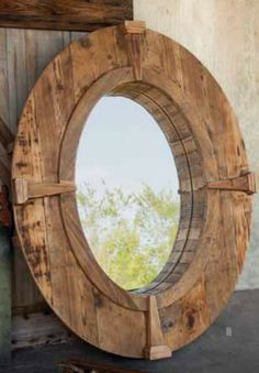 Rustic Oval Wooden Farm Mirror with Wood Frame and Decorative Wood Compass Points... for the top of the stairs.