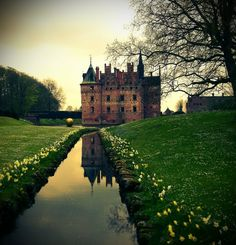 Egeskov Castle is located in the south of the island of Funen, Denmark. Egeskov Castle is built on oak piles driven into the bed og the lake. It is said that a whole forest was felled to provide timber for the foundations. The castle is Europe's best preserved Renaissance water castle.