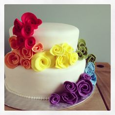 Rainbow wedding cake .....I could put the real flowers on instead of icing flowers