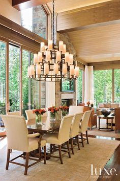 Contemporary Neutral Dining Room with Three-Tiered Chandelier