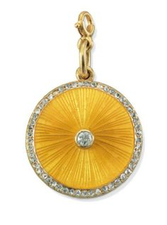A Jeweled and Guilloché Enamel Locket  By Fabergé, with the workmaster's mark of August Holmström, St. Petersburg, circa 1890 Circular, the hinged cover enameled in translucent yellow over a sunburst guilloché ground and centering a diamond, with a rose-cut diamond border, the reverse reeded, marked on suspension loop 1 7/8 in. (4.8 cm.) long overall