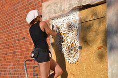 Polish artist NeSpoon combines lace-making, ceramics and street art.