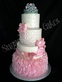 My latest cake! 4 tiered buttercream Quinceanera cake with handmade fondant ruffles on bottom tier. The ruffles alone took over 4 hours to create! Sugarkissed Cakes TX