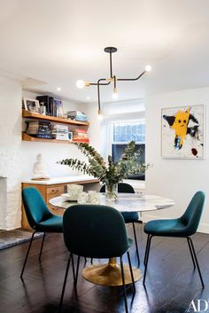 """""""We wanted a round dining table and looked at the classic Saarinen table but loved Organic Modernism's spin on the original design with this beautiful marble top and hammered brass base,"""" says Harris. """"It is incredibly heavy!"""""""