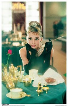 """Breakfast at Tiffanys"" starring AUDREY HEPBURN.  She was the definition of lovely."