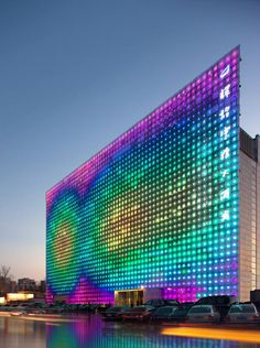 """Designed by Simone Giostra & Partners Architects along with the ninja masters over at Arup, the LED media wall will """"provide the city of Beijing with its first venue dedicated to digital media art, while offering the most radical example of sustainable technology applied to an entire building's envelope to date"""" says Giostra. The building opens to the public in June of 2008, marked by special video installations and performances by a number of different artists."""